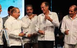 Dominican Republic President Danilo Medina, second from left, and Club Med President Henri Giscard d'Estaing, second from right, during the ribbon cutting for the Club Med Miches Playa Esmeralda.