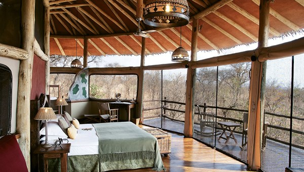 A room atop a tree at the Tarangire Treetops camp, with a deck from which to watch animals from the comfort of rocking chairs.