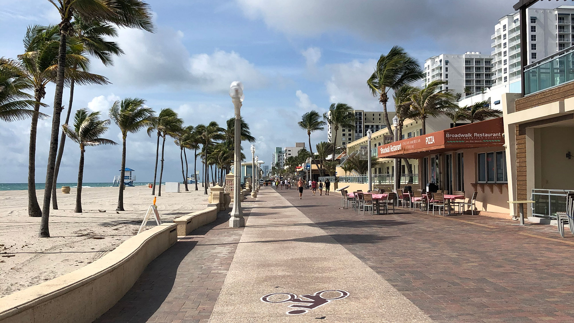 Wading into an uncertain summer season on Hollywood Beach