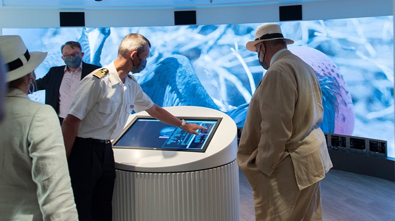 Dutch shipyard De Hoop delivered the Silver Origin, an expedition ship bound for the Galapagos, in a June 3 ceremony. An officer showed Silversea chairman Manfredi Lefebvre, far right, the interactive, LED wall in the Origin's Basecamp area.