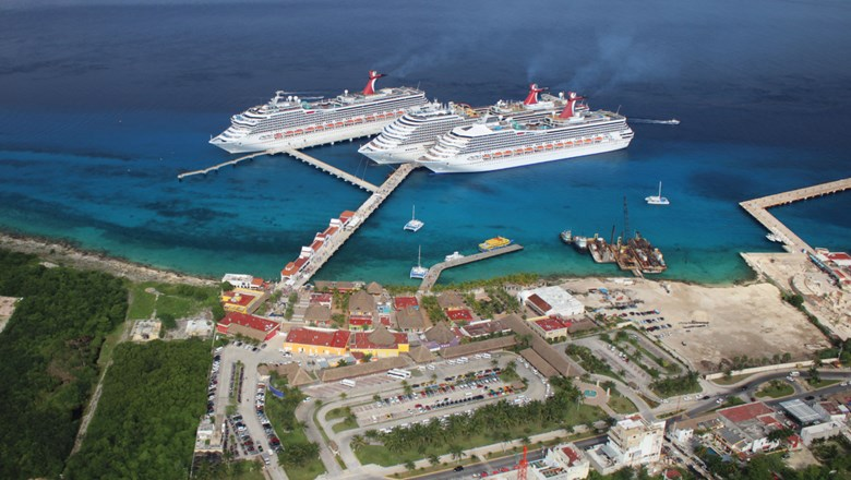 Carnival Cruise Line ships in Cozumel, Mexico. As it works towards a restart, the cruise industry must work with port authorities and governments to agree on health protocols.