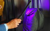 An ultraviolet sanitizing wand is used by staff to clean luggage at 1 Hotel Brooklyn Bridge.