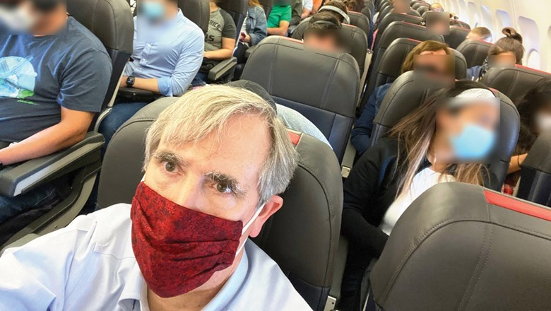 Democratic Sen. Jeff Merkley of Oregon tweeted this photo of a crowded American Airlines plane on July 2. American is among the airlines that aren't blocking seats.