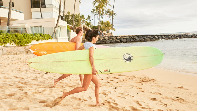 Professional surfers flock to Hawaii in the winter for the big swells, but the islands are a great place for learning how to surf all year round.