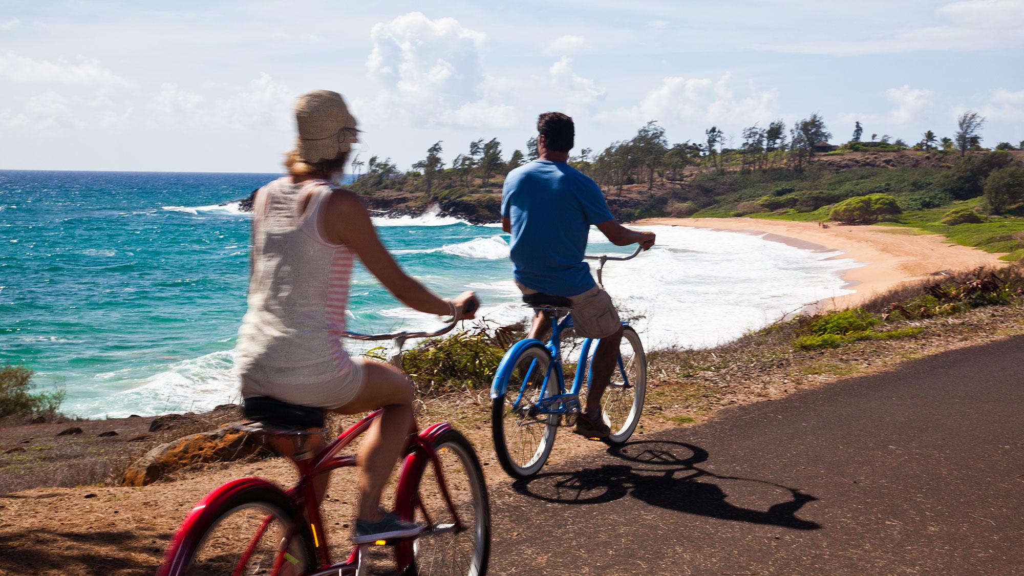 A couple bikes on the Ke Ala Hele Makalae path along Kauai's eastern coastline.