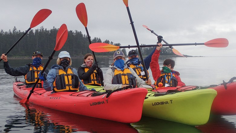 Passengers on the Wilderness Adventurer in kayaks during the line's first Alaska cruise in 2020, which was cut short after a passenger's Covid test came back positive.