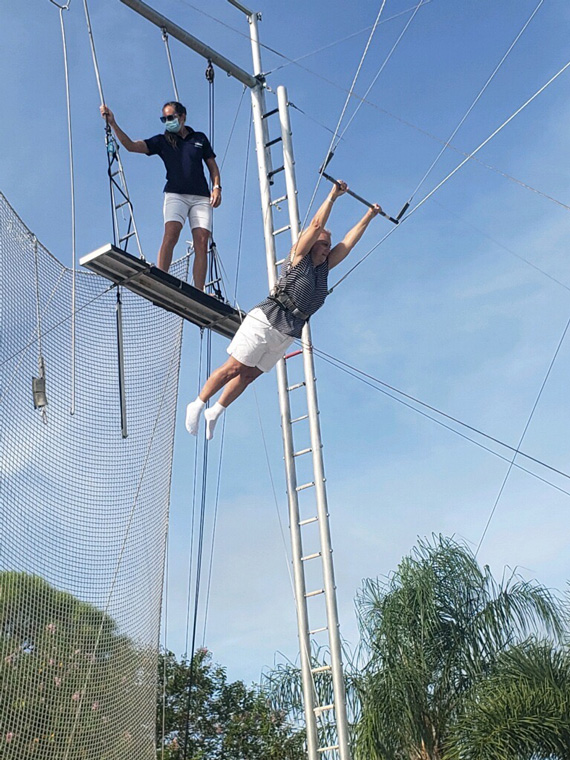 Jami Turner tries out the trapeze at Club Med Sandpiper Bay in Port St. Lucie, Fla.