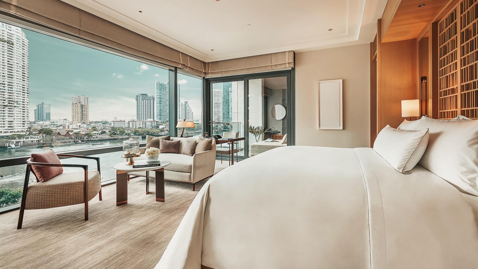 A guestroom at the Capella Bangkok overlooking the Chao Phraya River.