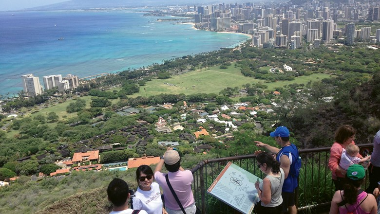 Visitors in pre-Covid times at the summit of Diamond Head, overlooking the Waikiki district of Honolulu.