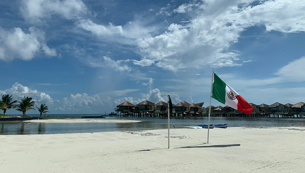 The Mexcan flag planted on the beach of the El Dorado Maroma in Riviera Maya.