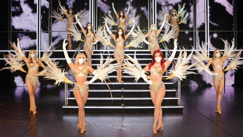 "Dancers wear masks in the Royal Caribbean International original production ""Showgirl: Past. Present. Future"" on the Quantum of the Seas."