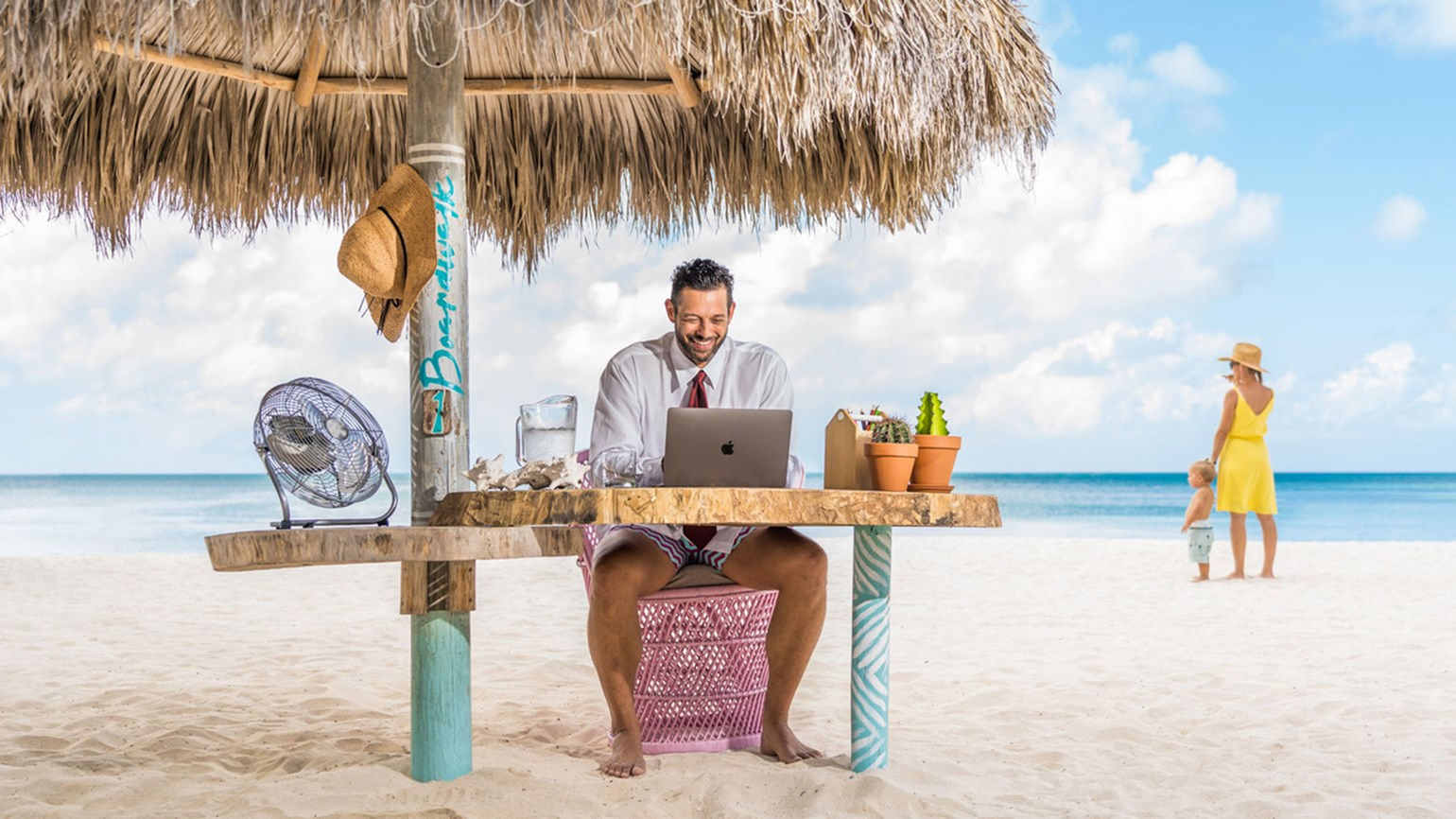 A workstation that encourages toes in the sand? This resort has the answer.