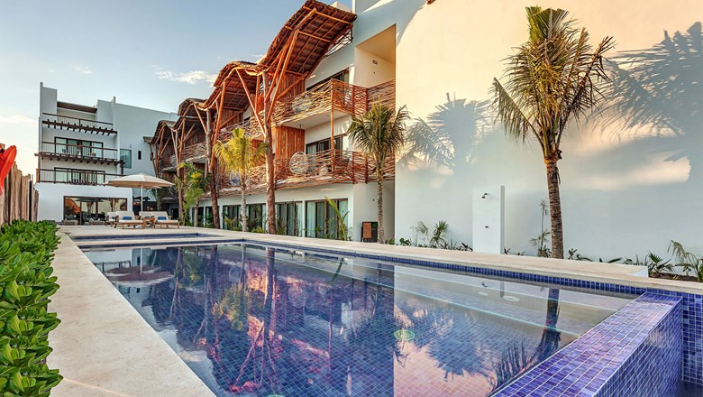The pool deck at the Mystique Holbox by Royalton resort, which is joining Marriott International's Tribute Portfolio.