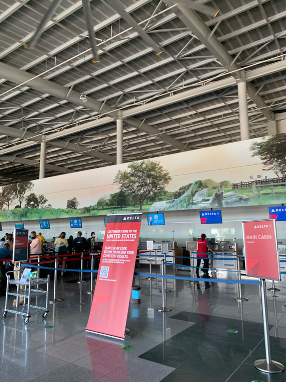 The check-in process at Liberia Airport was smoother for Delta, which has  adopted technology to let travelers scan QR codes that verify they have the negative Covid tests needed to enter the U.S. American manually checks documents.