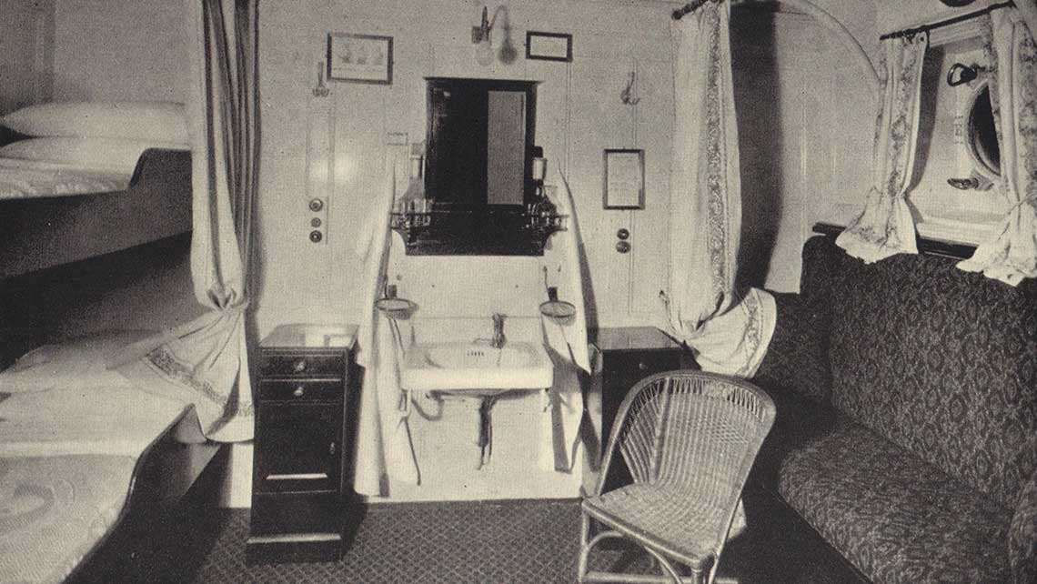 """A cabin on Cunard's Laconia, which in April 1922 departed on the company's first World Cruise. The ship was described as a """"most modern and luxurious club"""" offering """"famous Cunard cuisine and service."""""""