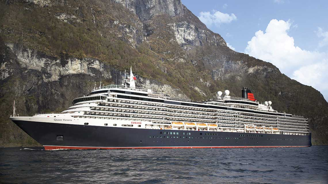 Cunard's Queen Victoria in the Norwegian Fjords. The ship will embark on a world cruise touching many of the same ports Cunard's RMS Laconia visited in 1922-23.
