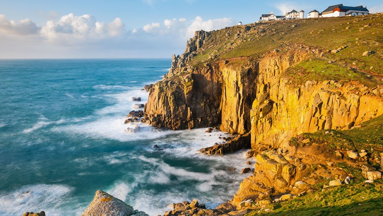 A falling pound means Americans will pay less for a U.K. vacation. Pictured, Land's End, a big tourism draw in England.