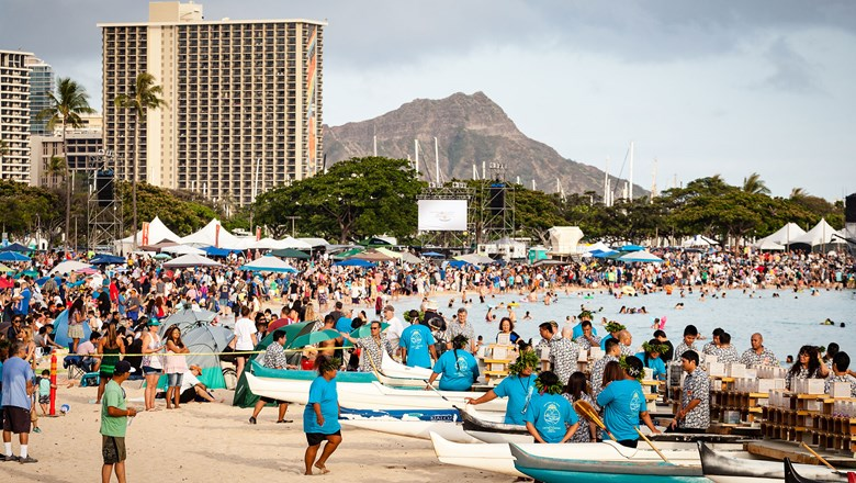 A lantern-floating ceremony draws a crowd at Ala Moana Beach Park in Honolulu.