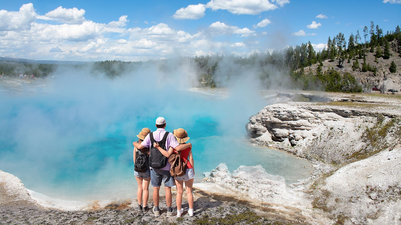 Yellowstone Geyser, Family at Midway Geyser Basin [Credit: Margaret W./Shutterstock.com]