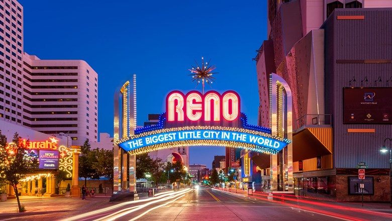 The historic Reno Arch, with the Harrah's casino on the left.