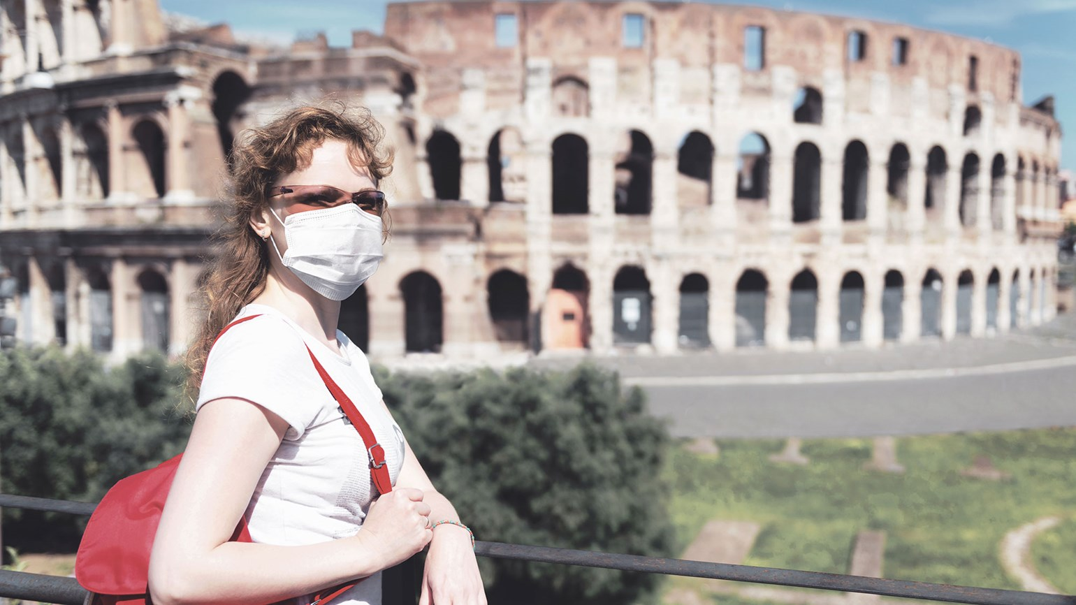 Colosseum in Rome, masked woman
