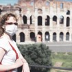 Colosseum in Rome, masked woman [Credit: Viacheslav Lopatin/Shutterstock.com]