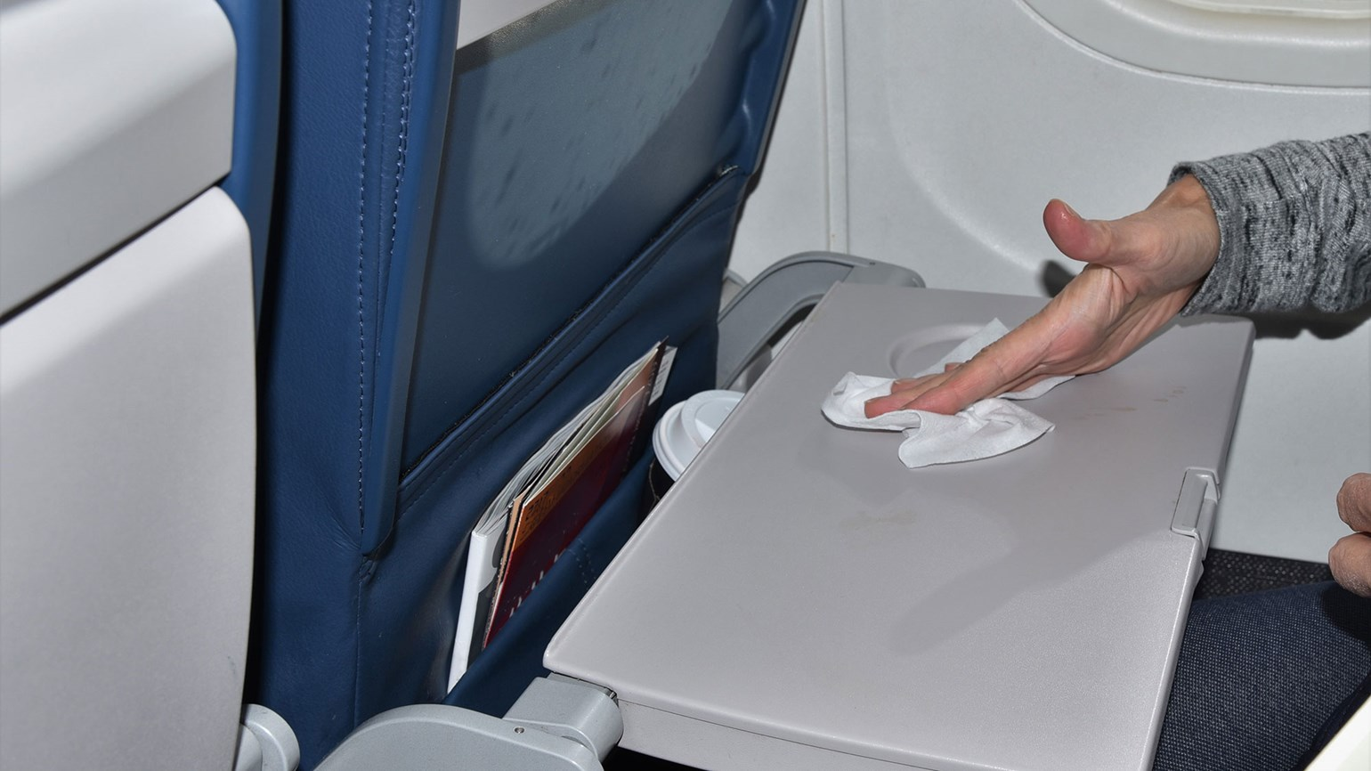 Airplane tray table wiped