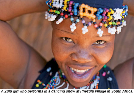 A Zulu girl performs in a dancing show at Phezulu village in South Africa.