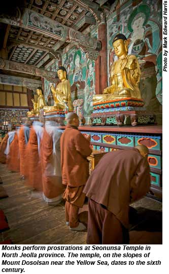 Monks perform prostrations at Seonunsa Temple.