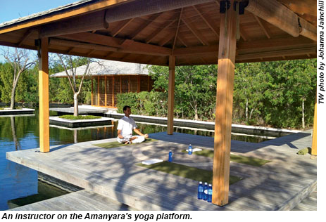 A yoga instructor at Amanyara