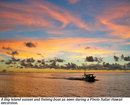 A Big Island sunset and fishing boat as seen during a Photo Safari Hawaii excursion.