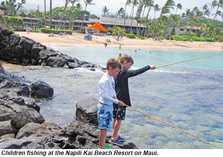 Children fishing at the Napili Kai Beach Resort on Maui.