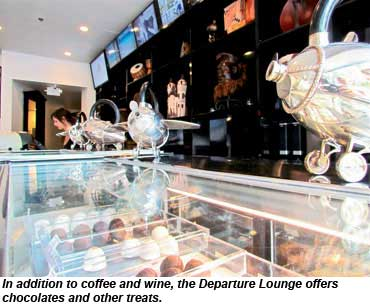 In addition to coffee and wine, the Departure Lounge offers chocolates and other treats.