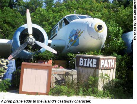 A prop plane adds to the islands castaway character.