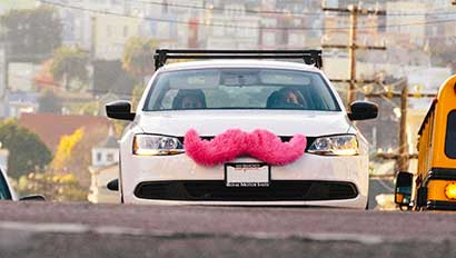 Lyft car with pink mustache