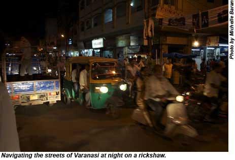 Navigating the streets of Varanasi at night on a rickshaw.