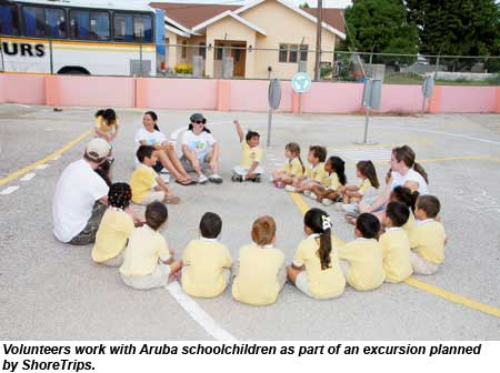 Volunteers work with Aruba schoolchildren as part of an excursion planned by ShoreTrips.