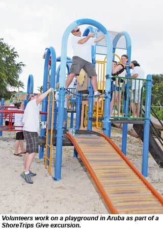 Volunteers work on a playground in Aruba as part of a ShoreTrips Give excursion.
