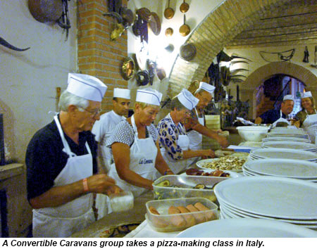 A Convertible Caravans group takes a pizza-making class in Italy.