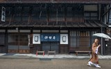 A monk makes his way through the rain in the town of Narai on the historic Nakasendo.