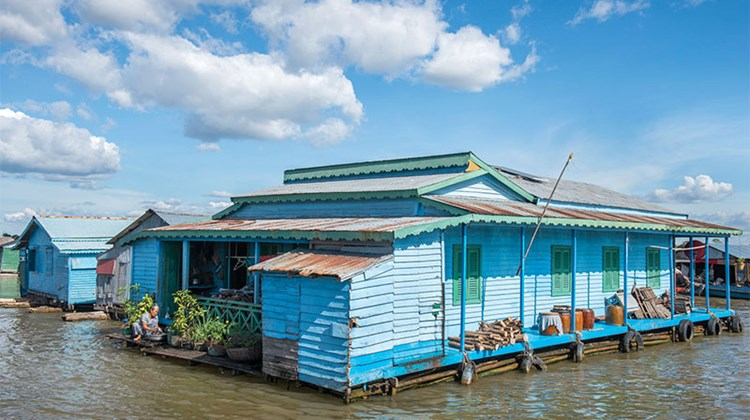 A floating house on the Tonle Sap River in Cambodia.