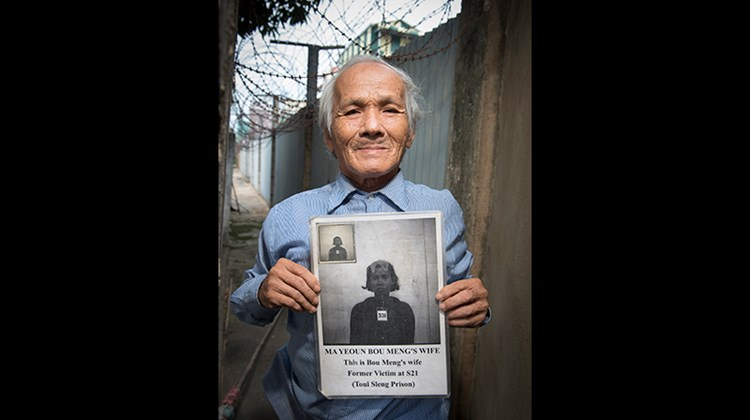 Bou Meng, one of the few survivors of the Khmer Rouge's notorious Security Prison 21 in Phnom Penh, holds a picture of his wife who was executed by the regime. The prison has been converted into the Toul Sleng Genocide Museum.