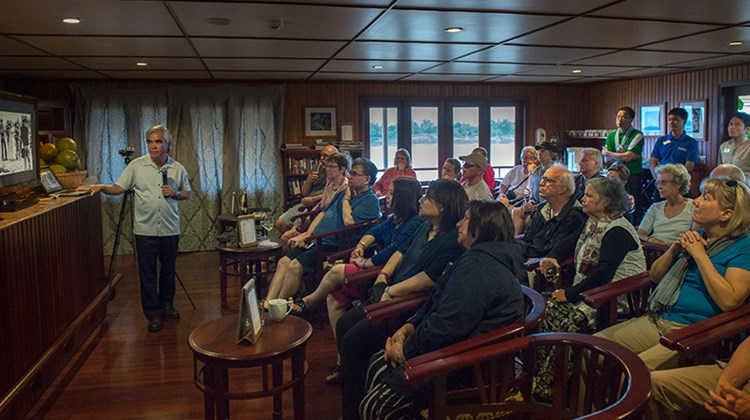 While sailing to the Cambodia/Vietnam border, Pulitzer-Prize winning photographer Nick Ut presents his images of the Vietnam War onboard Uniworld's River Orchid.