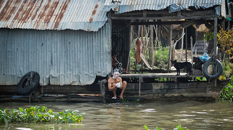 A man washes himself with the waters of the Mekong in Chau Doc.