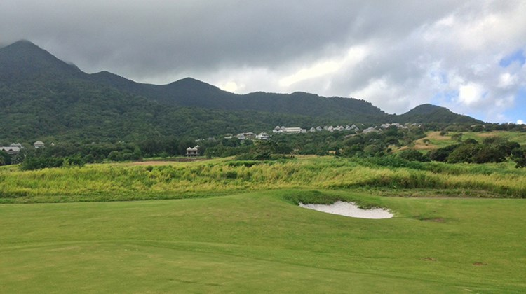 The backdrop for the Irie Fields golf course is Mount Liamuiga and its fertile slopes in many shades of green.