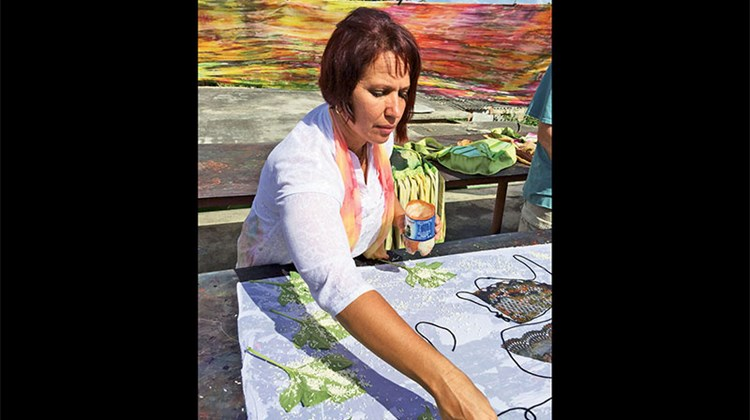 Fashion designer Mariela Aleman Orozco displayed her fabric-painting technique in Cardenas, Cuba.