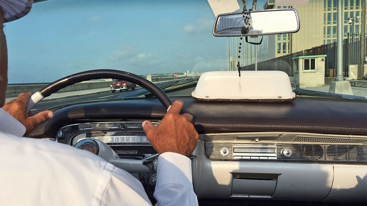 Driving along the Malecon in Havana in a '59 Chevy convertible.