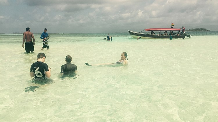 Visitors relax on one of the shallow sandbar ''swimming pools'' that are dotted among the islands.