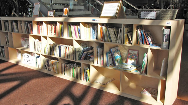 A make-shift library in the Tallinn Airport, where passengers are invited to borrow books and to contribute books.