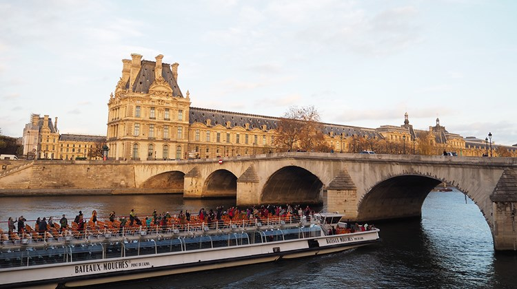 Not all tourists had vanished from Paris in the wake of the attacks, including those on this Seine River sightseeing cruise, which sailed past the Louvre at sunset.